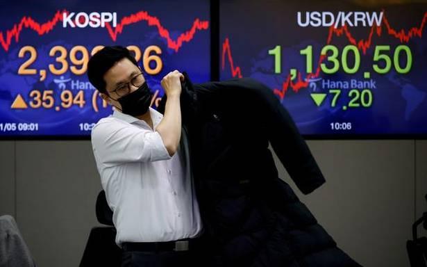 Asian shares slip on broader risk sentiment