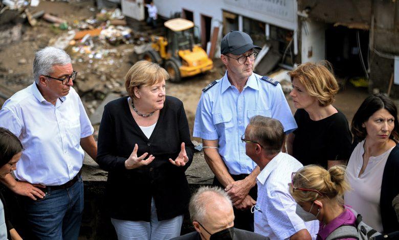 Angela Merkel vows 'faster' battle against climate change amid floods