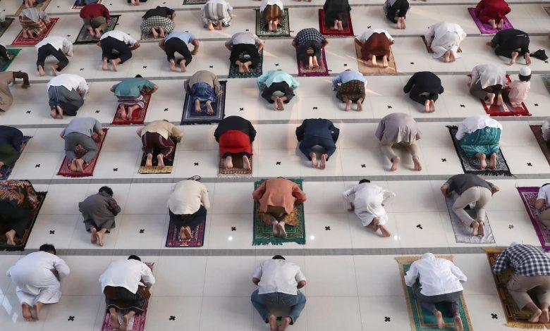 Indonesian Muslims mark grim Eid amid devastating virus wave