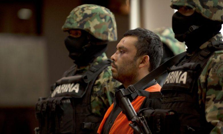 "Mexican marines escort Marcos Jesus Hernandez Rodriguez, aka ""El Chilango,"" the alleged leader of assassins and member of the Los Zetas drug cartel, in Veracruz state in Mexico City on May 11, 2012."