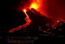 Thousands flee La Palma volcano eruption as rivers of lava flow towards villages