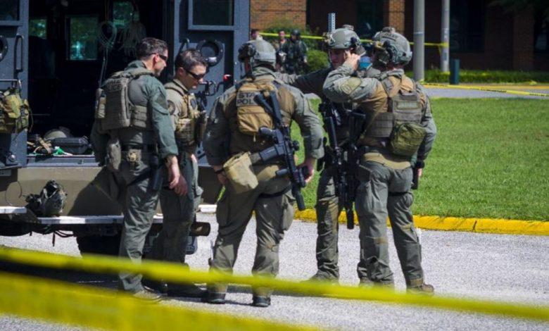 Virginia State Police SWAT Team members are seen outside Heritage High School in Newport News, Virginia, on Monday.